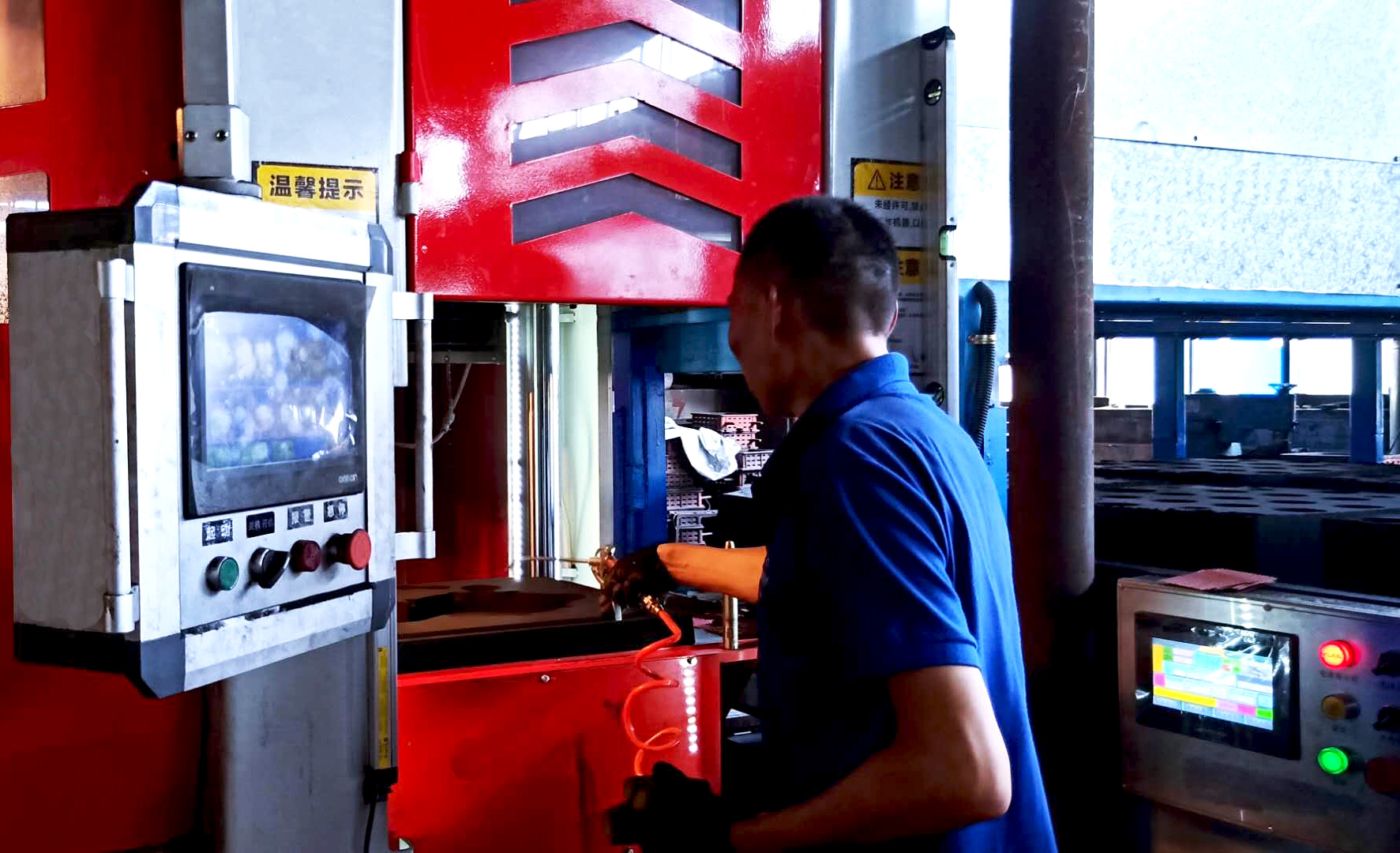 Foundry workers are working on the molding machine